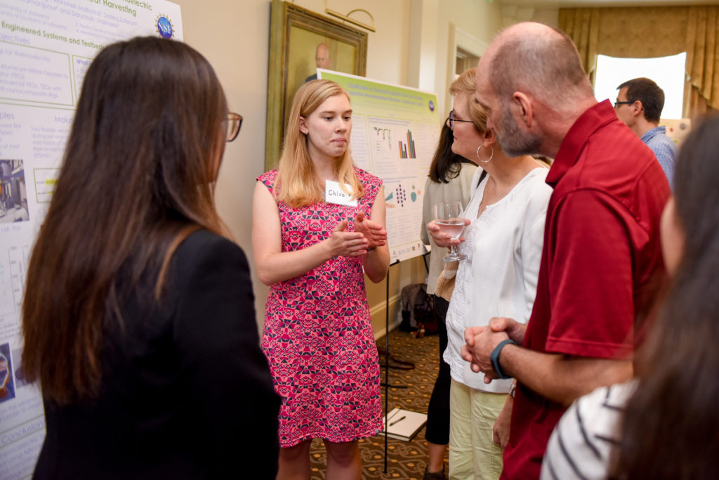 Student presenting her research at the annual research symposium.